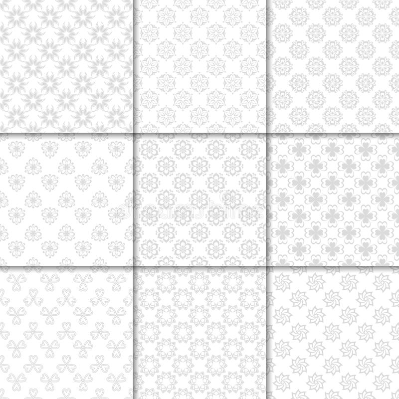 Floral gray and white seamless patterns. Backgrounds with fower elements for wallpapers. royalty free illustration