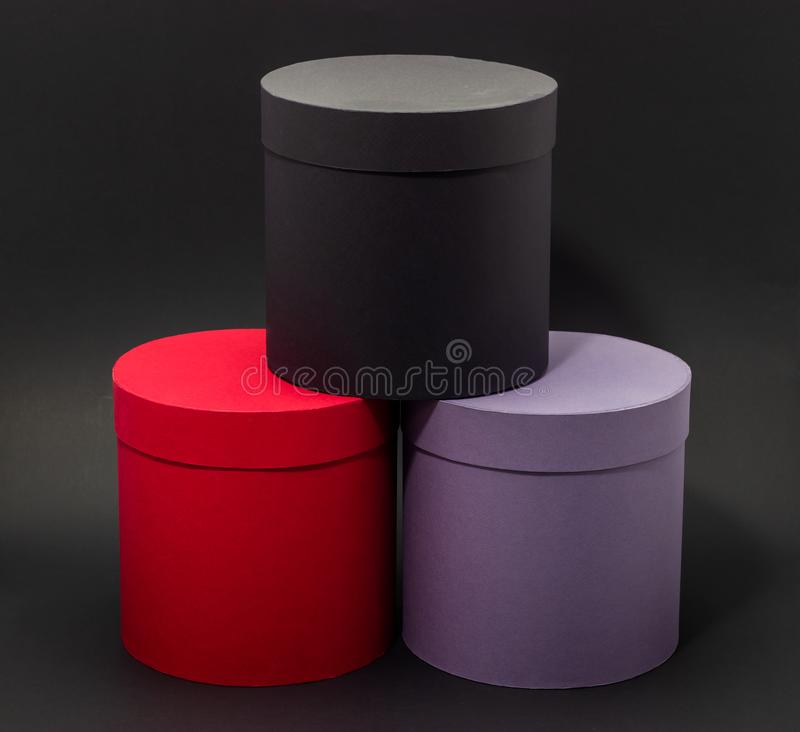 Floral hat boxes on a dark background mockup in design royalty free stock images