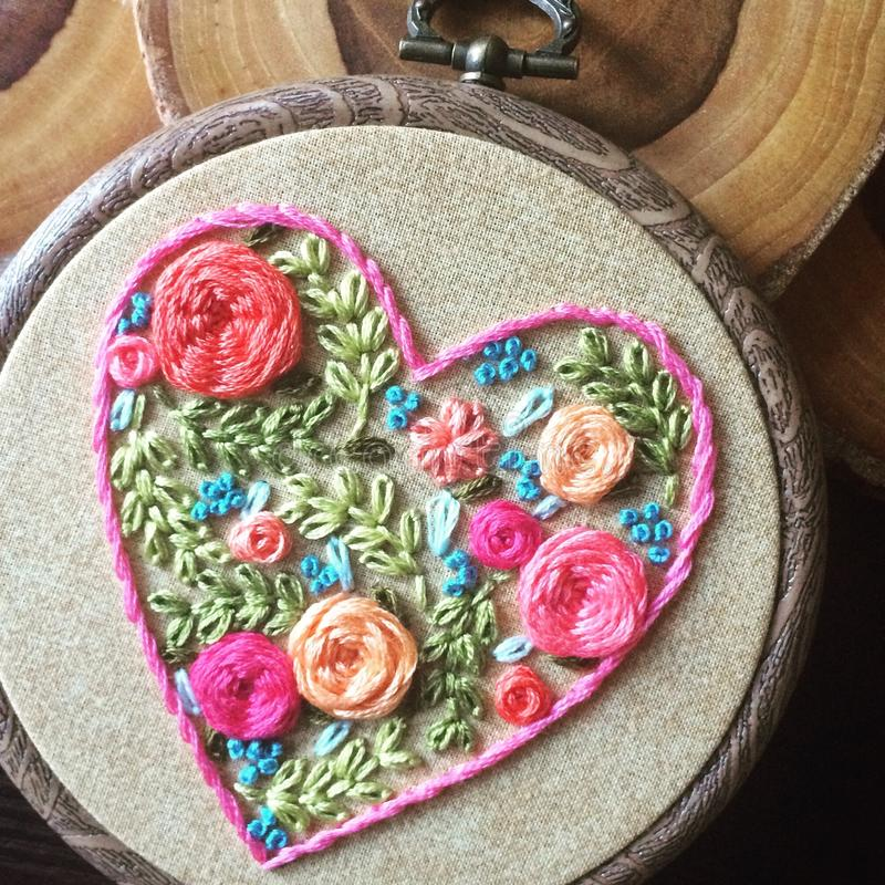 Floral Heart. Hand embroidery floral spring heart stock image