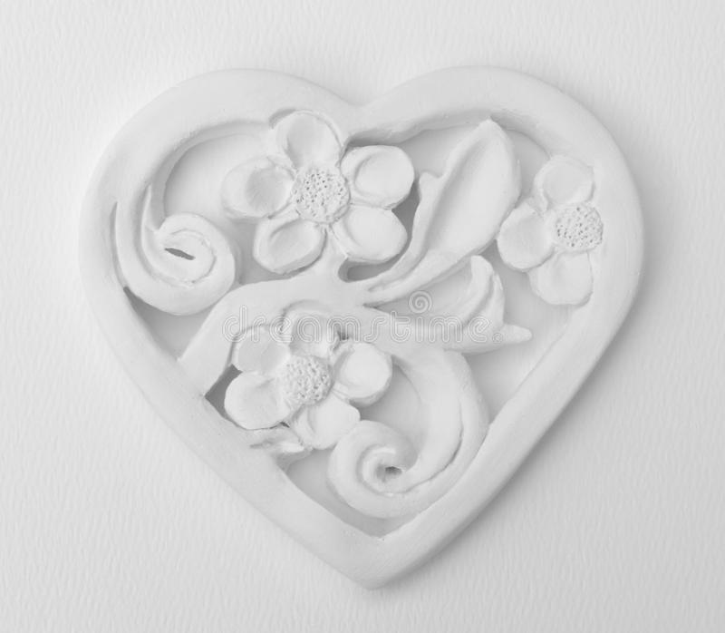 Floral heart. White plaster floral heart background royalty free stock photos