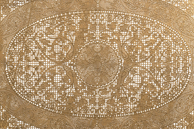 Floral lace background, close up. Golden color royalty free stock photo