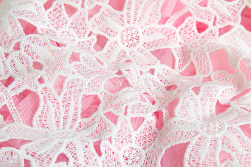 Floral lace background. Floral lace layered over a pink tutu stock photography