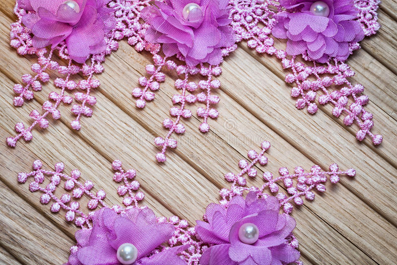 Floral lace. On a wooden background with copy space. Suitable as a wedding invitation stock photos