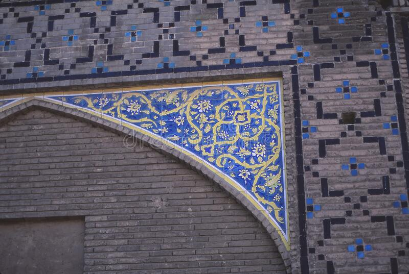 Floral mosaic on exterior of Madrese-e Khan stock images
