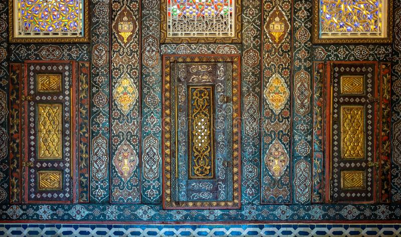 Floral ornaments of wooden embedded cupboards painted with colored geometrical patterns, Cairo, Egypt stock photo