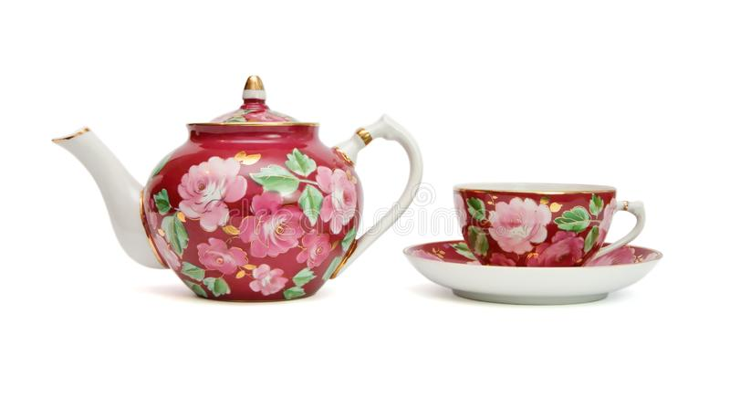 Floral-painted tea service isolated. Old-fashioned floral-painted tea service isolated royalty free stock photo