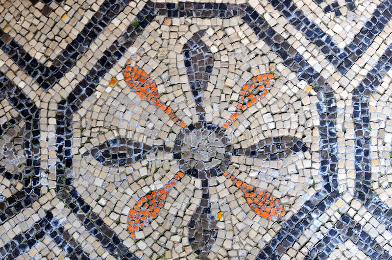 Floral pattern. Decorative floral pattern in ancient roman mosaics on the UNESCO listed floor of the basilica of Aquileia in Italy royalty free stock photos