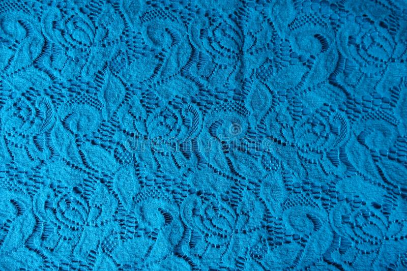 Floral pattern on blue lace. From above royalty free stock photo
