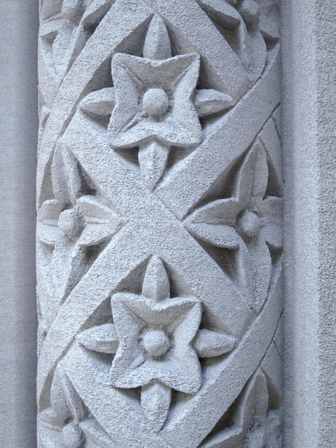 Floral pattern carved into a stone pillar stock image
