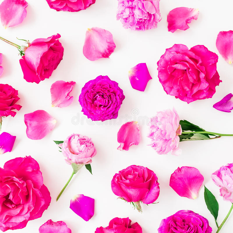 Floral pattern of peony flowers, roses and leaves on white background. Flat lay, top view. Floral lifestyle composition. Floral pattern of peony flowers, roses royalty free stock photo
