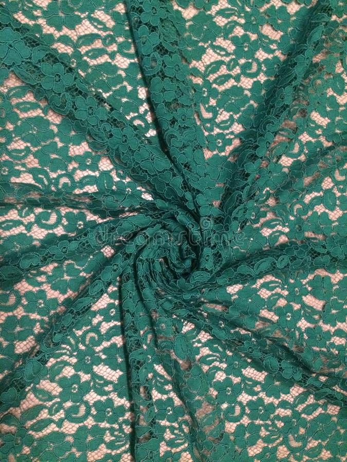 Floral patterned green lace. Fabric royalty free stock photography