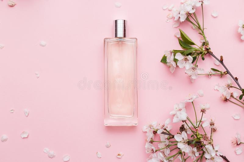 Floral perfume bottle with orchid flowers royalty free stock photos