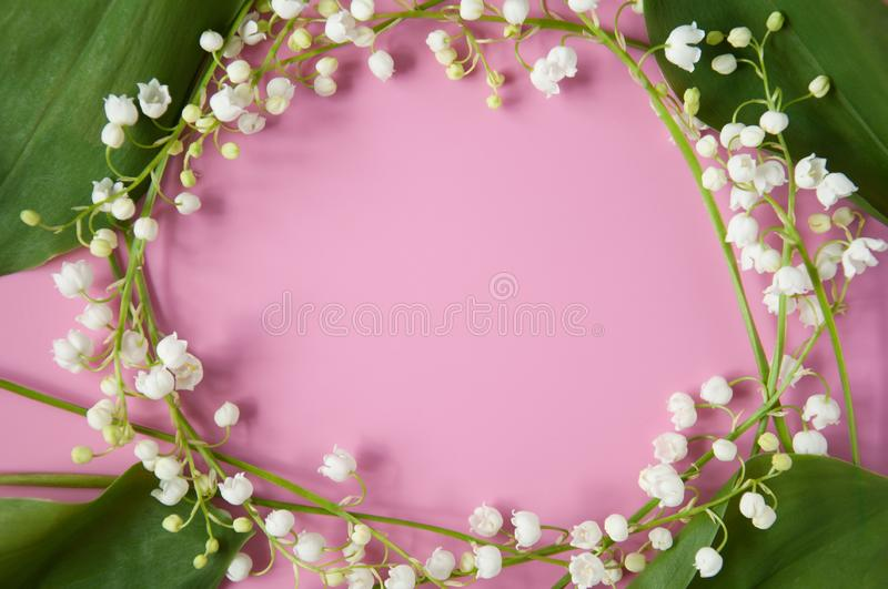Floral pink background with fresh flowers. Lilies of the valley frame. Spring greeting card. Congratulations on Mother`s Day, Birt stock photos