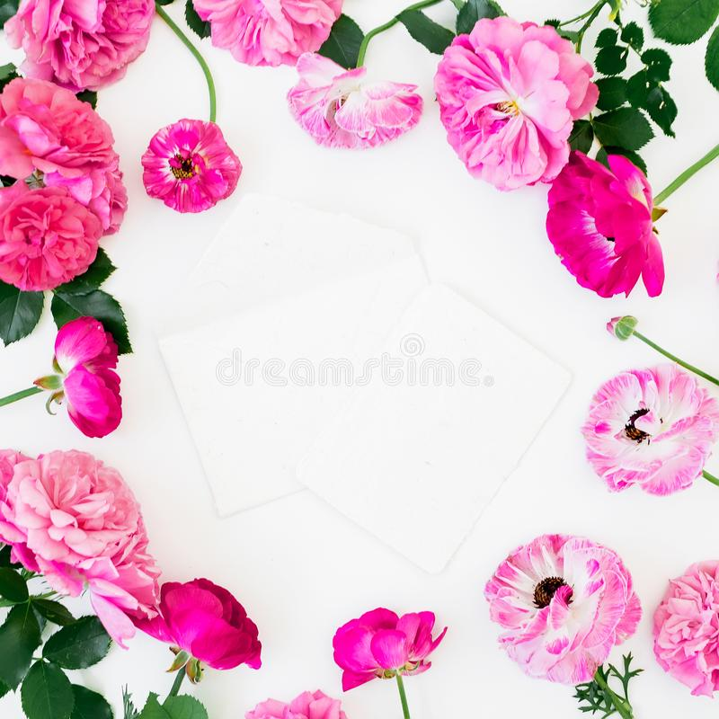Floral round frame of roses and anemone flowers on white background. Flat lay, Top view. Pastel flowers texture royalty free illustration