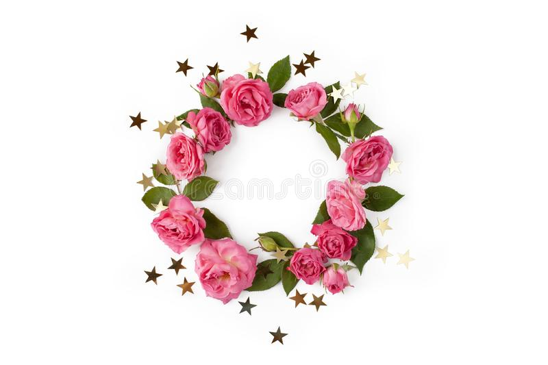 Floral round wreath. Flowers frame made of roses, leaves and golden stars isolated on white background royalty free stock image