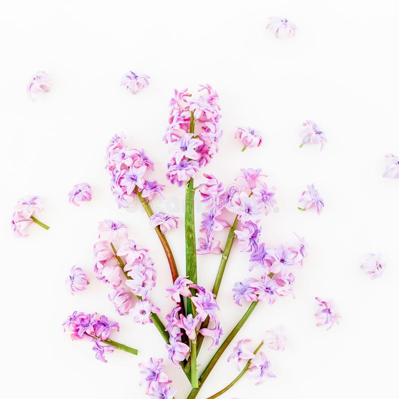 Floral spring bouquet with pink flowers on white background. Flat lay, top view. Valentines day royalty free stock photo