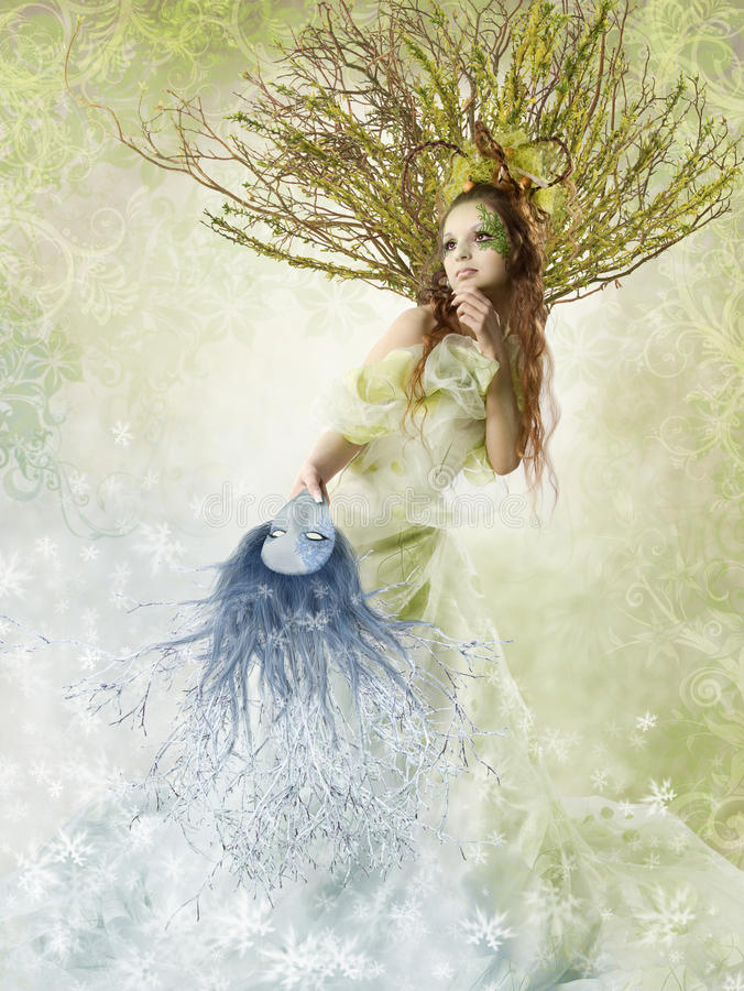 Floral spring woman. Beautiful spring woman holding winter mask. Change of seasons. Floral background royalty free stock photos