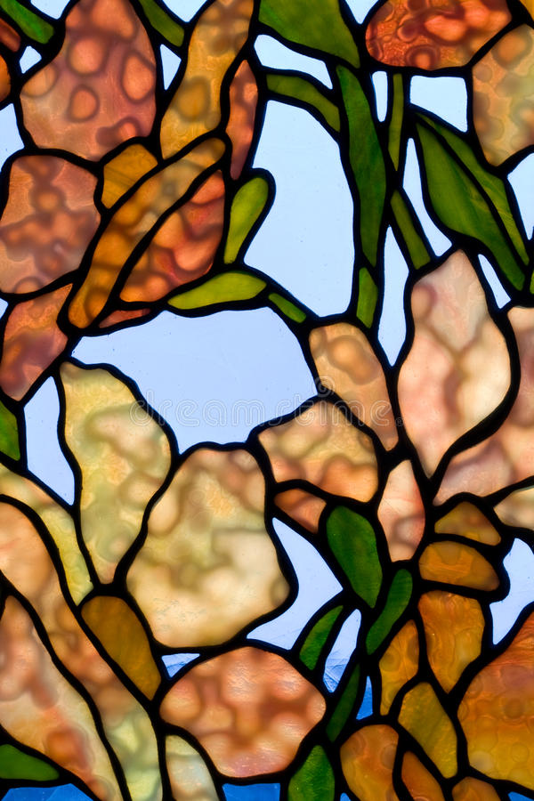 Floral stained glass panel. Tiffany-style stained glass panel stock photography