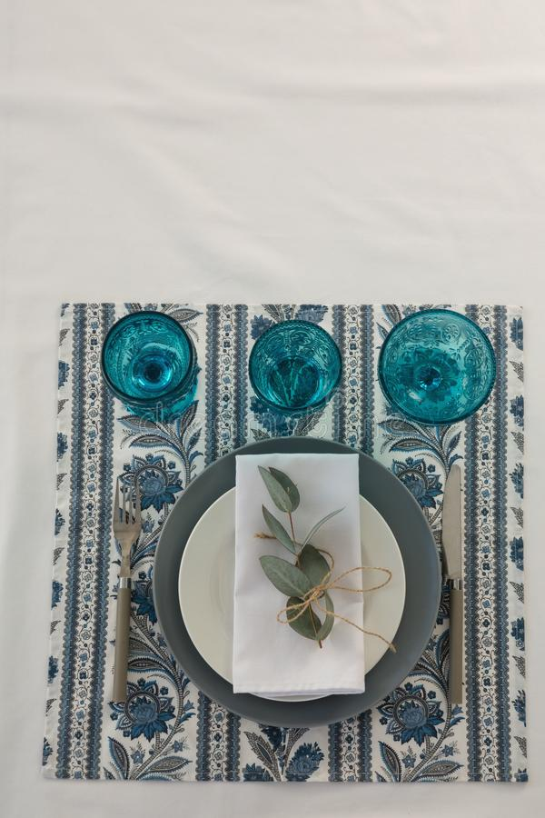 Floral theme table setting. Close-up of floral theme table setting stock images