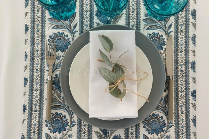 Floral theme table setting. Close-up of floral theme table setting royalty free stock photos