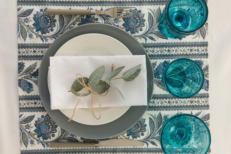 Floral theme table setting. Close-up of floral theme table setting royalty free stock photo