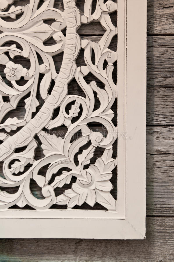 Floral wall frame. Hanging on worn wooden boards royalty free stock photos