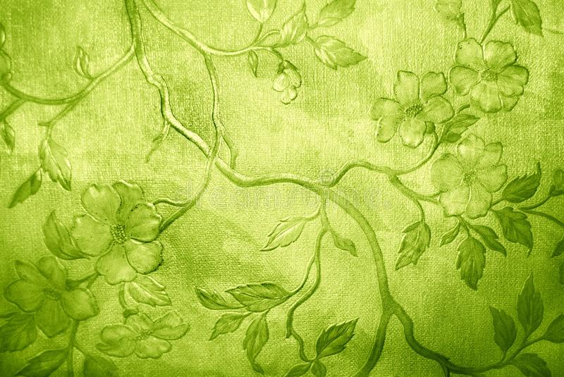 Floral wallpaper. Green floral grunge wallpaper on leather texture royalty free stock images
