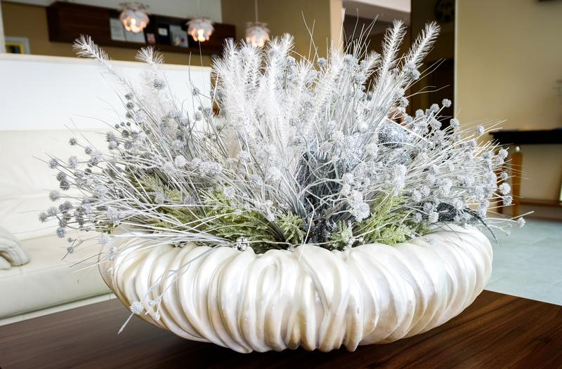 Floral white table decoration in hotel lobby reception room. stock photos