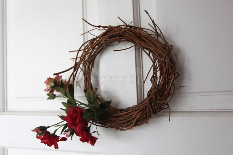 Floral wreath made up of flowers and dried twigs royalty free stock photos
