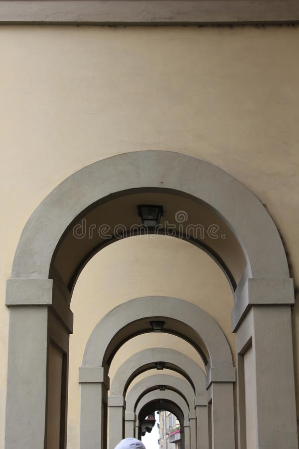 Florence Arch Architecture. Image of the Arch alongside Ponte Vecchio bridge. I love the geometry of the shpa, many arch, light and shadow royalty free stock photo