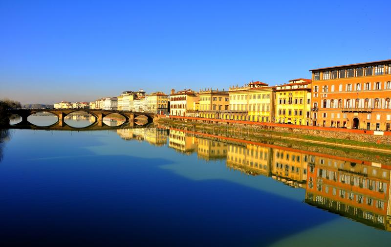 Florence city center , Italy. Buildings and bridges mirror in the river Arno in Florence, Italy stock photos