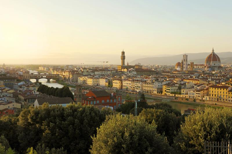 Florence city during golden sunset. Panoramic view of the river Arno with Ponte Vecchio bridge, Palazzo Vecchio palace and royalty free stock image