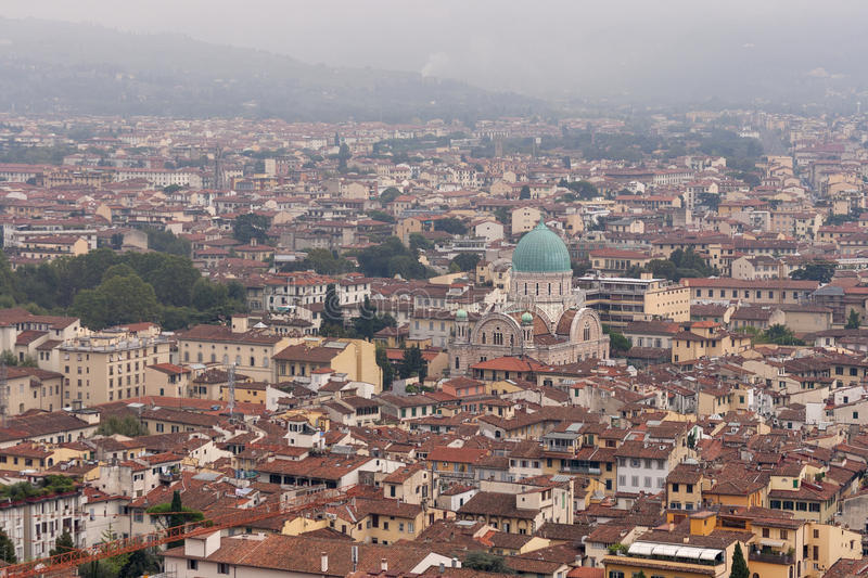 Florence cityscape with Jewish Temple in the fog royalty free stock image