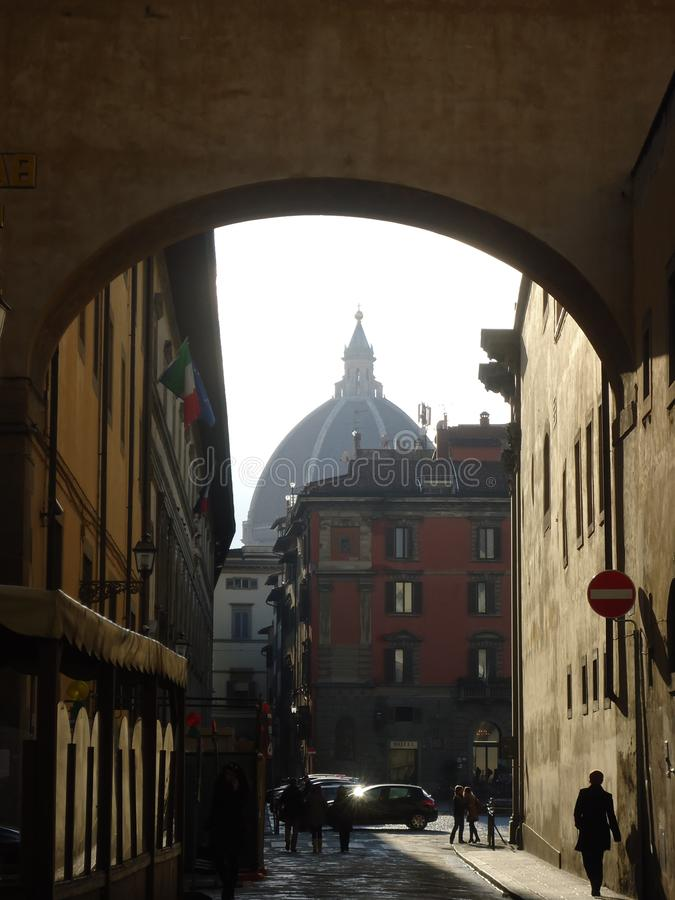 Florence Dome in the arch. Florence Cathedral. Travel in Italy, Europe. Background stock photography