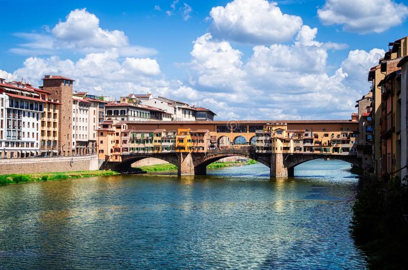 Florence or Firenze, a view of the Arno River and the Ponte Vecchio Bridge royalty free stock photos