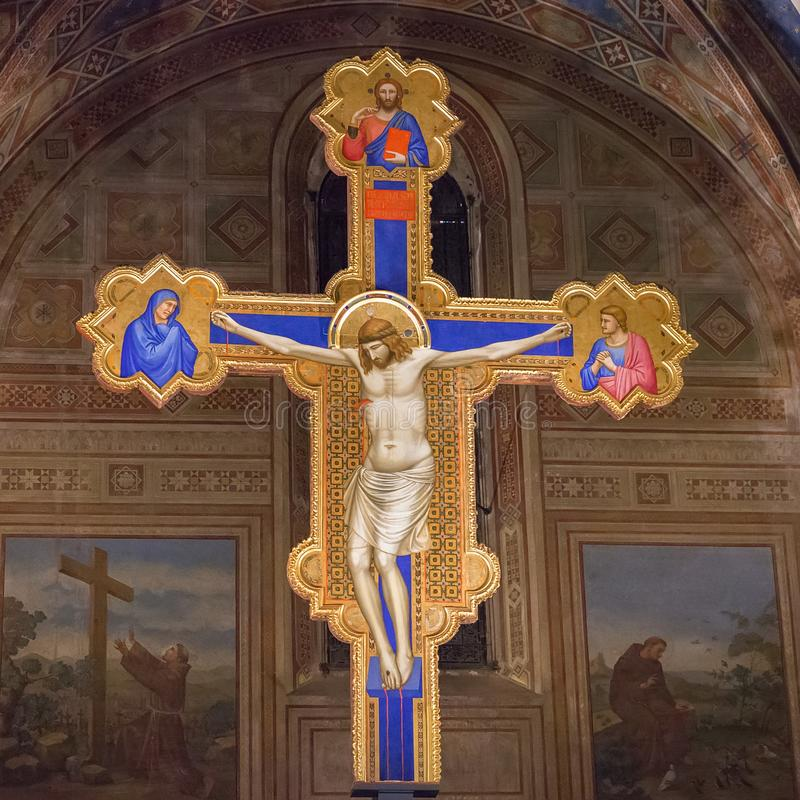 Inside of Ognissanti or Church of All Saints in Florence, cross royalty free stock photography