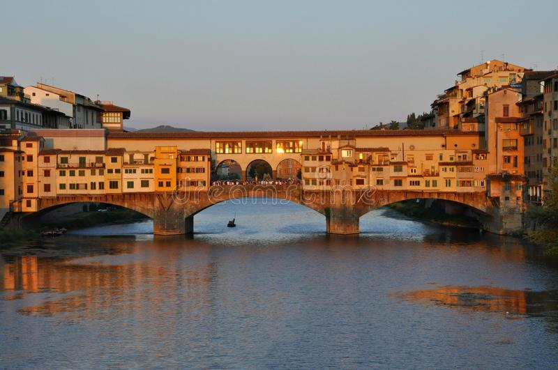 Florence, Italy. Florence cityscape with clear blue sky. Ponte vecchio , the famous old bridge over the river Arno . Sunsetting in the famous italian city royalty free stock image