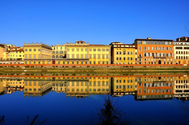 Buildings by the river in Florence city , Italy. Buildings mirror in the river Arno in Florence city, Italy royalty free stock photography