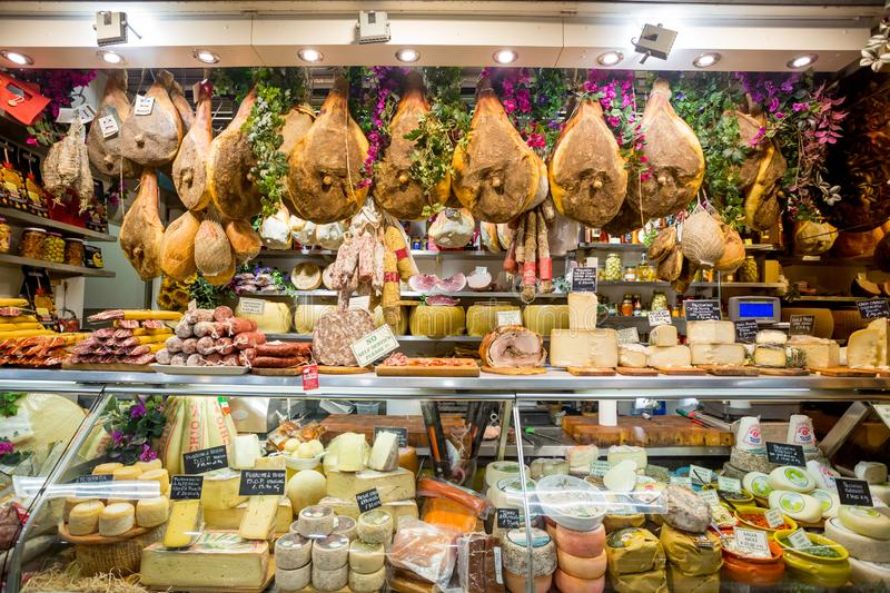 Florence, Italy - April 7, 2018: Farmers shop display of cheese and meat in San Lorenzo market.  royalty free stock images