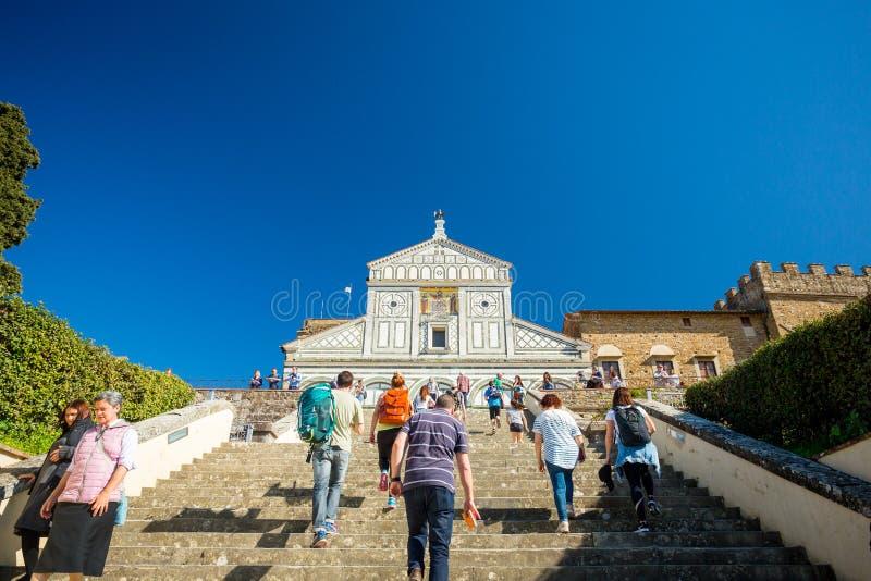 Florence, Italy - April 7, 2018: San Miniato al Monte Abbey. Tourist climbing stairs royalty free stock photography