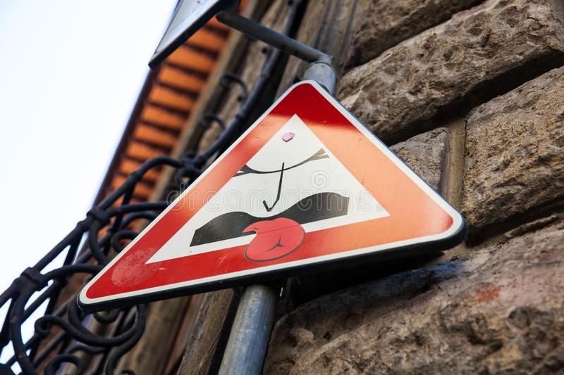 Florence street sign art by Clet Abraham royalty free stock image