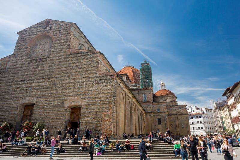 Florence, Italy - April 7, 2018: Tourist on the stairs of Basilica di San Lorenzo stock photos
