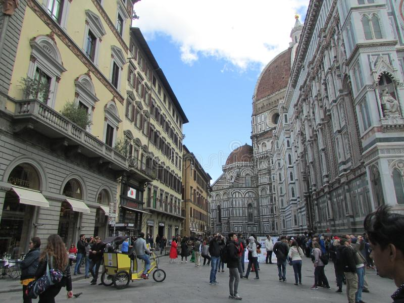 Florence, Italy, the central square. Crowds of tourists. On the left is the Catholic temple complex. stock photo