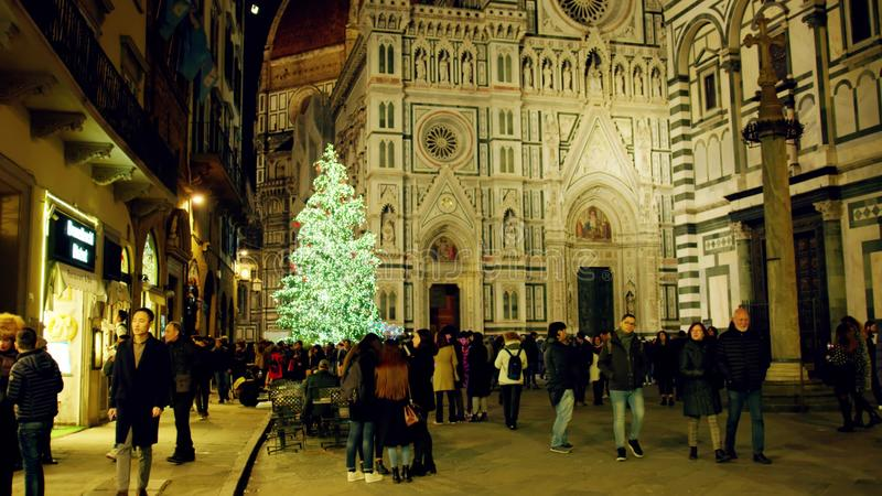 FLORENCE, ITALY - DECEMBER 26, 2018. Christmas tree in crowded place near Cathedral or Cattedrale di Santa Maria del royalty free stock image