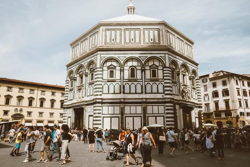 Panoramic view of exterior of Florence Baptistery on on the Piazza del Duomo. Florence, Italy - June 24, 2018: Panoramic view of exterior of Florence Baptistery royalty free stock photography
