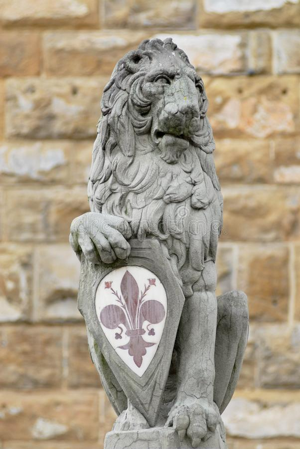 Stone Lion holding city`s main symbol at Piazza della Signoria in Florence, Italy. stock photos