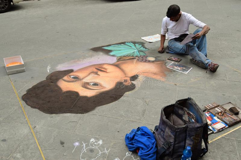 A street artist chalk drawing in Florence royalty free stock images