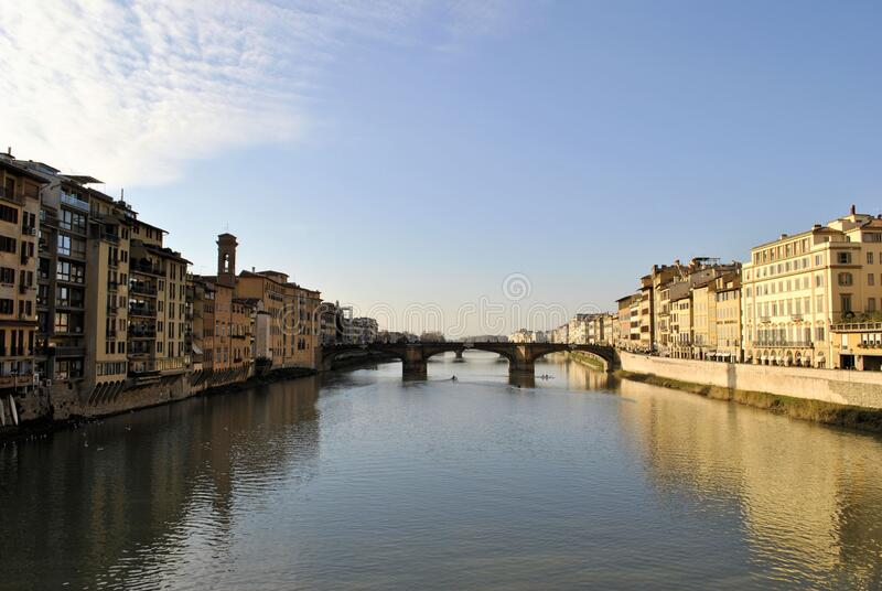 Florence old Italian town medieval buildings urban panorama beautiful cityscape water bridge sky background. Old medieval Italian town Florence city buildings royalty free stock image