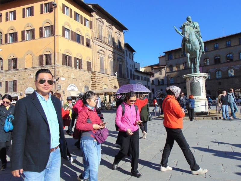 Florence Tuscany Italy, Marktplatz della Signoria, Quadrat von Signoria, Gruppe Touristen stockfotos