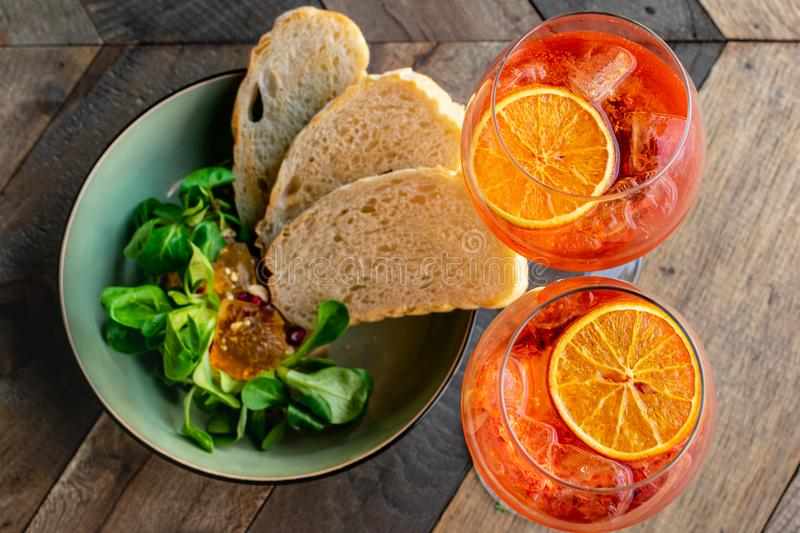 Italian aperitif `aperol stpritz` with ice and with appetizers royalty free stock photos
